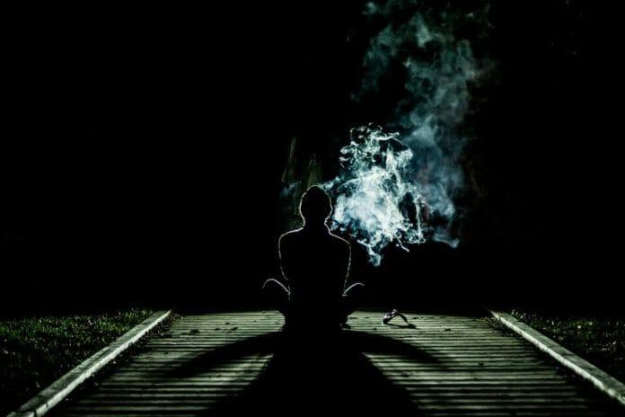Teen smoking on tracks