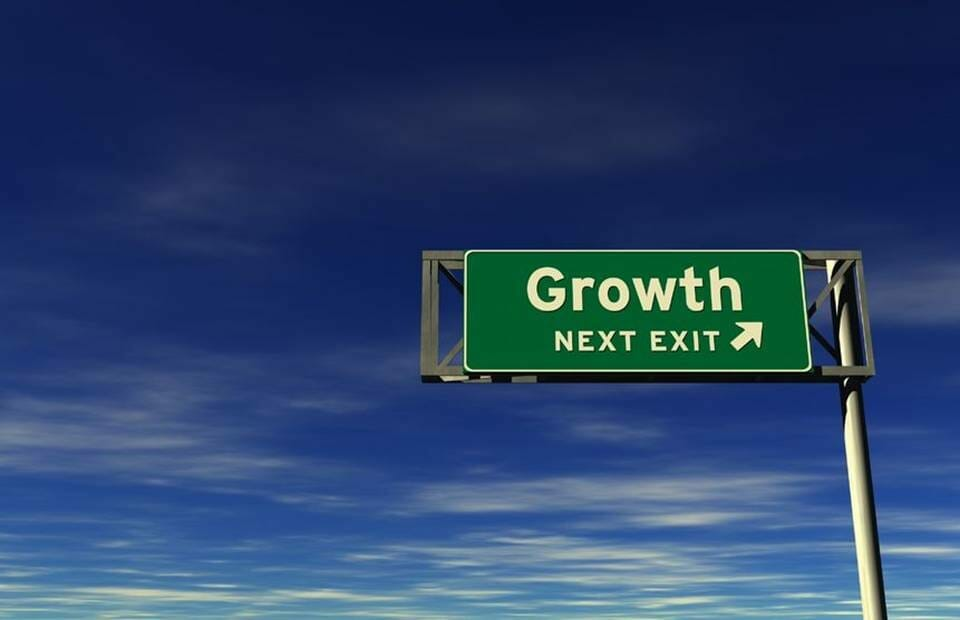 "A sign saying ""Growth next exit"""