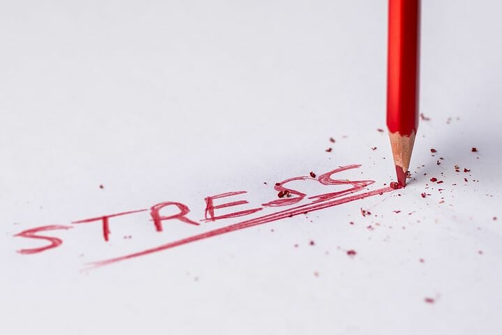 Pencil writing the word Stress