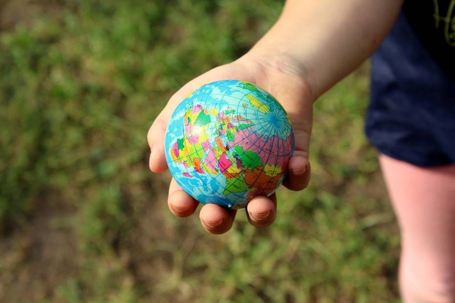 Child holding a small globe
