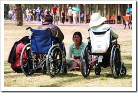 People in wheelchairs with carer