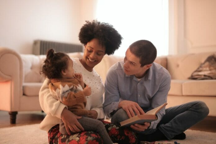 Parents reading to a little girl